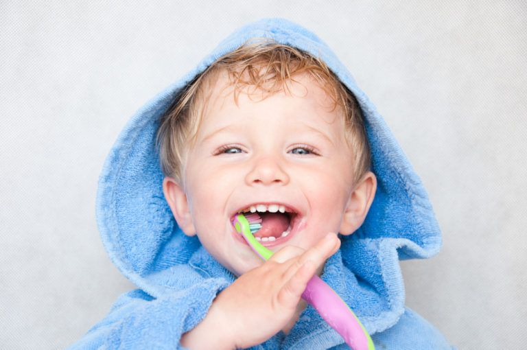 happy kid brushing his teeth - specialsmilesdentistry.com