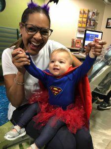 happy child hands in super costume halloween joyful doctor