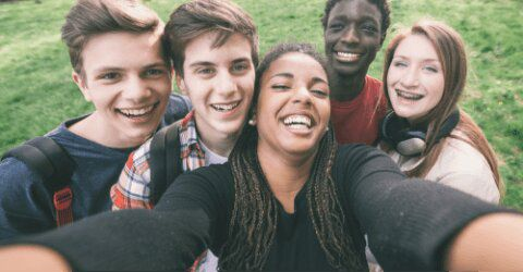 group of teens smiling