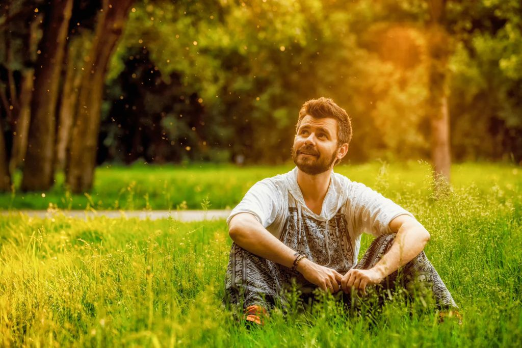 Man sitting outside in the grass
