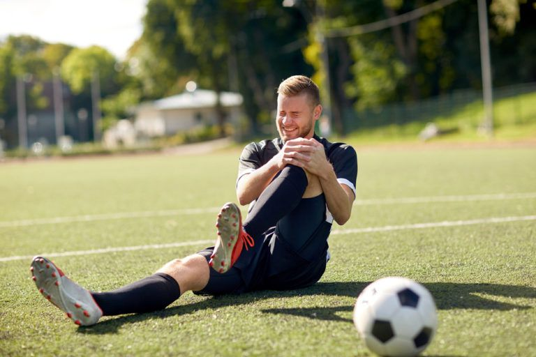 sport, football training, sports injury and people