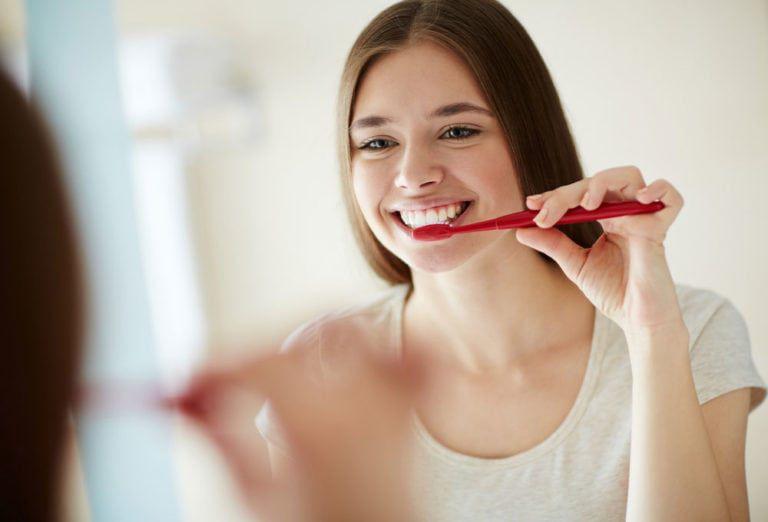 female brushing teeth