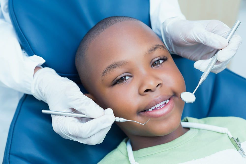 Small boy having dental checkup
