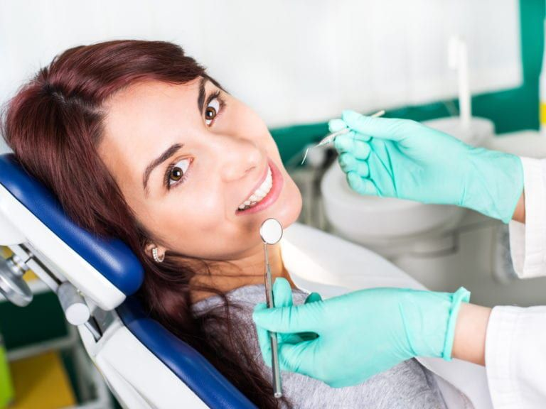 Female patient having dental checkup (Surgical Orthodontics)