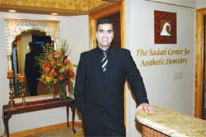Dr. Sadati standing in his practice