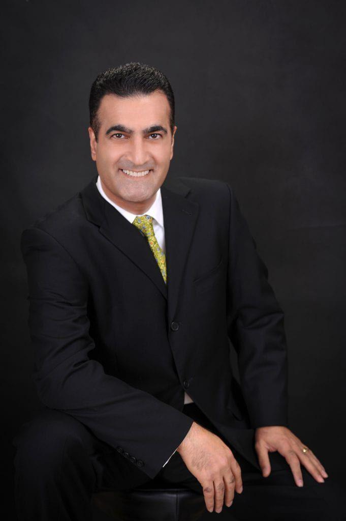 Dr. Sam Sadati wearing black suite portrait