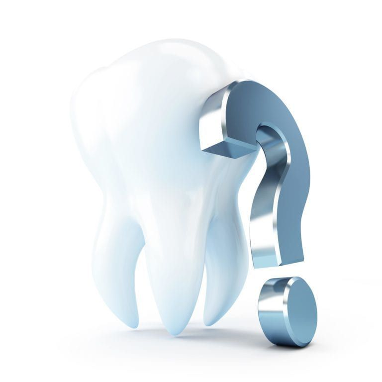 Question mark leaning on a tooth