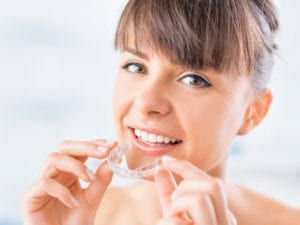 Woman with Invisalign Aligner