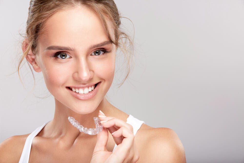dental patient with Invisalign brace