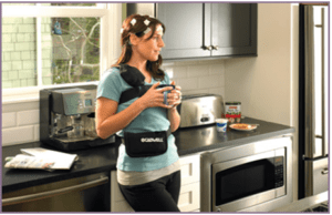 person in kitchen with brain monitoring device on