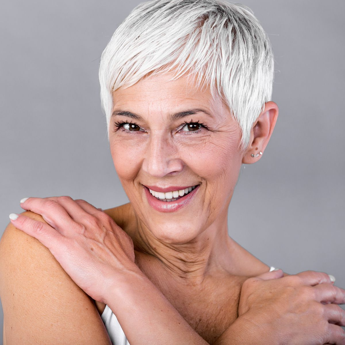 lose up portrait of happy with beaming smile female pensioner