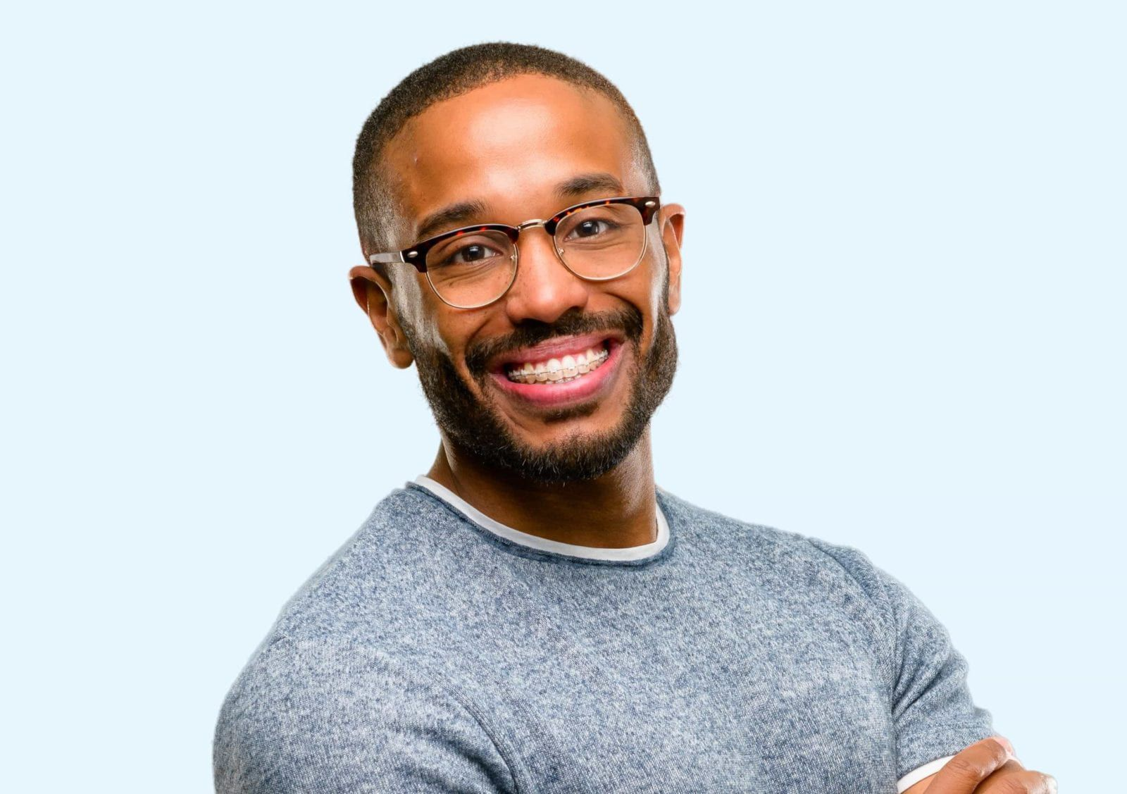 black man with braces smiling