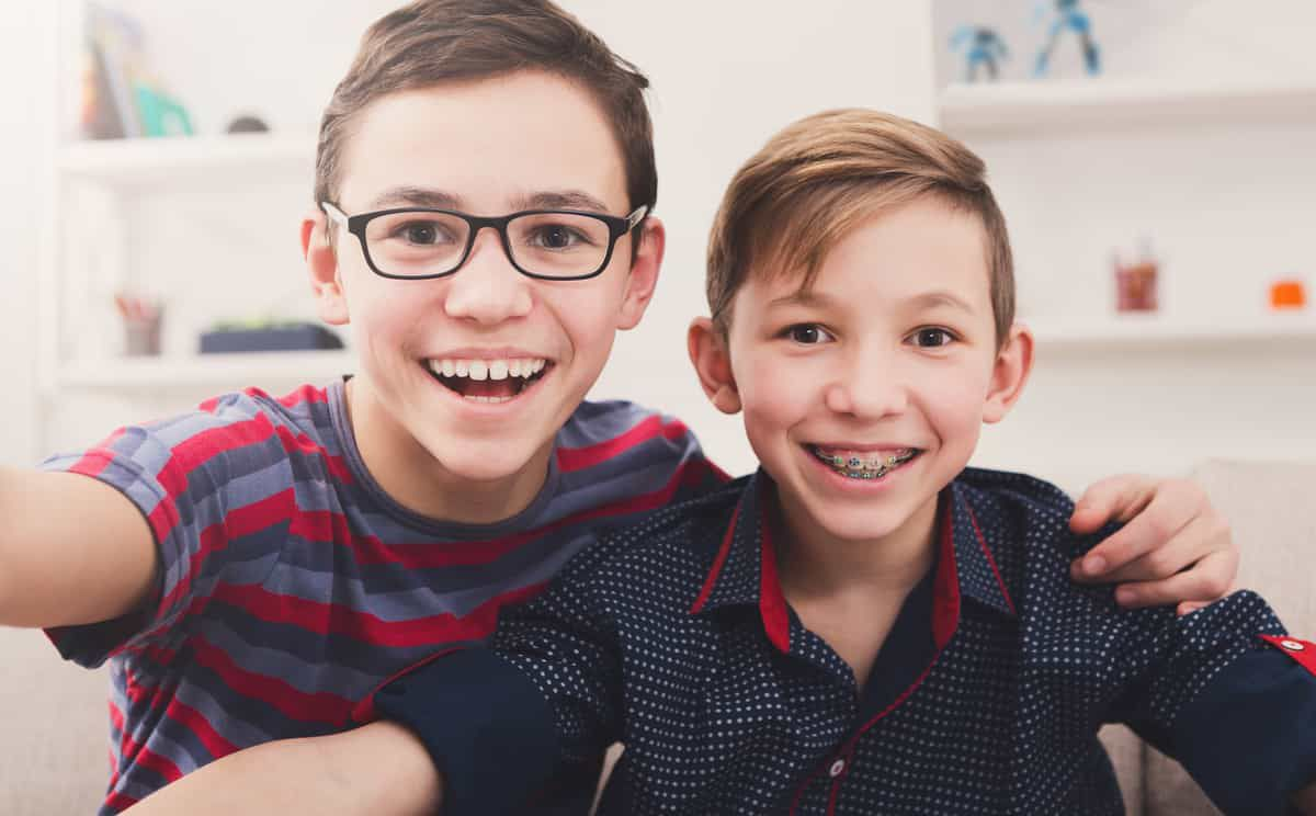 Kids smiling with braces