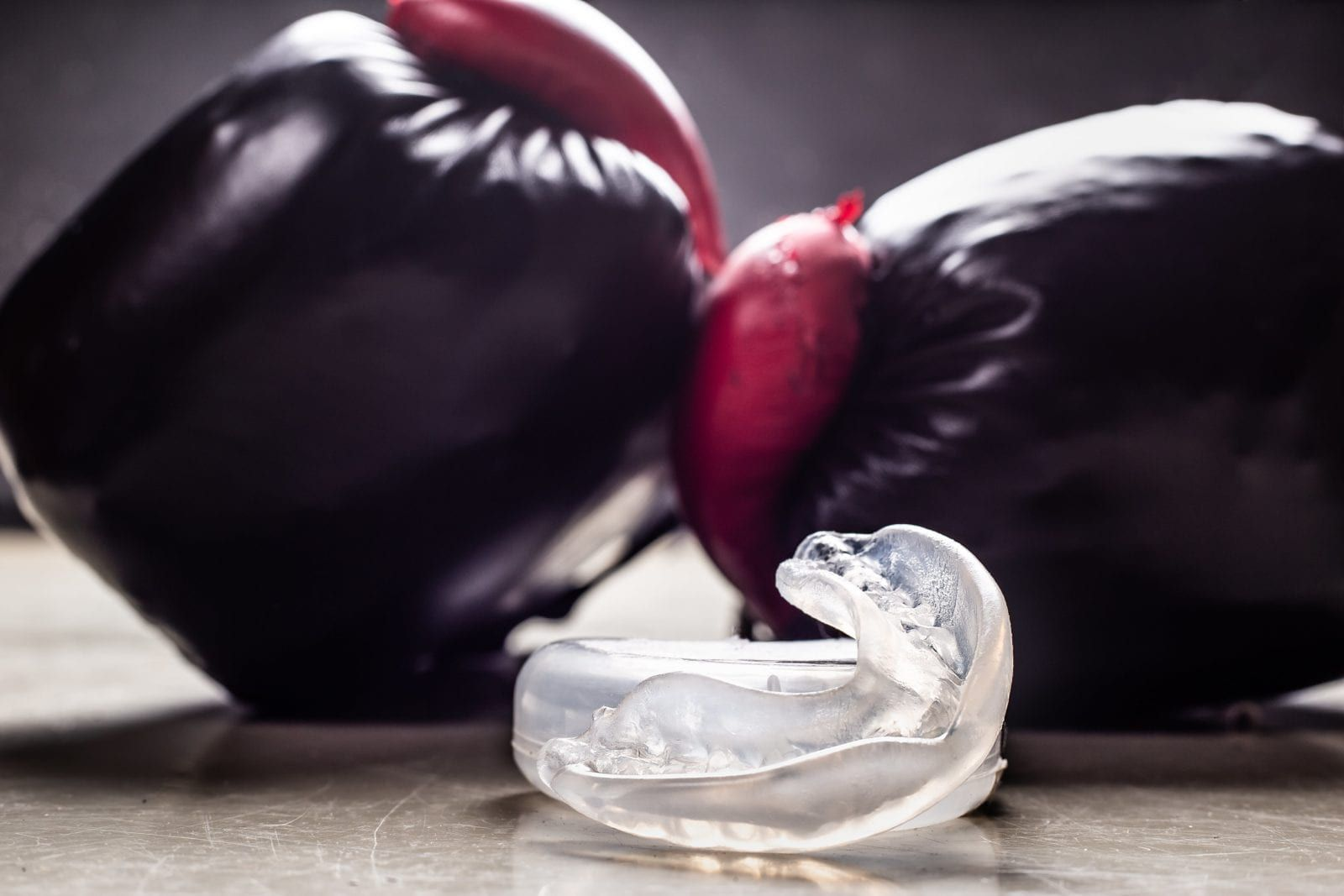 boxing gloves with a mouthguard in the middle