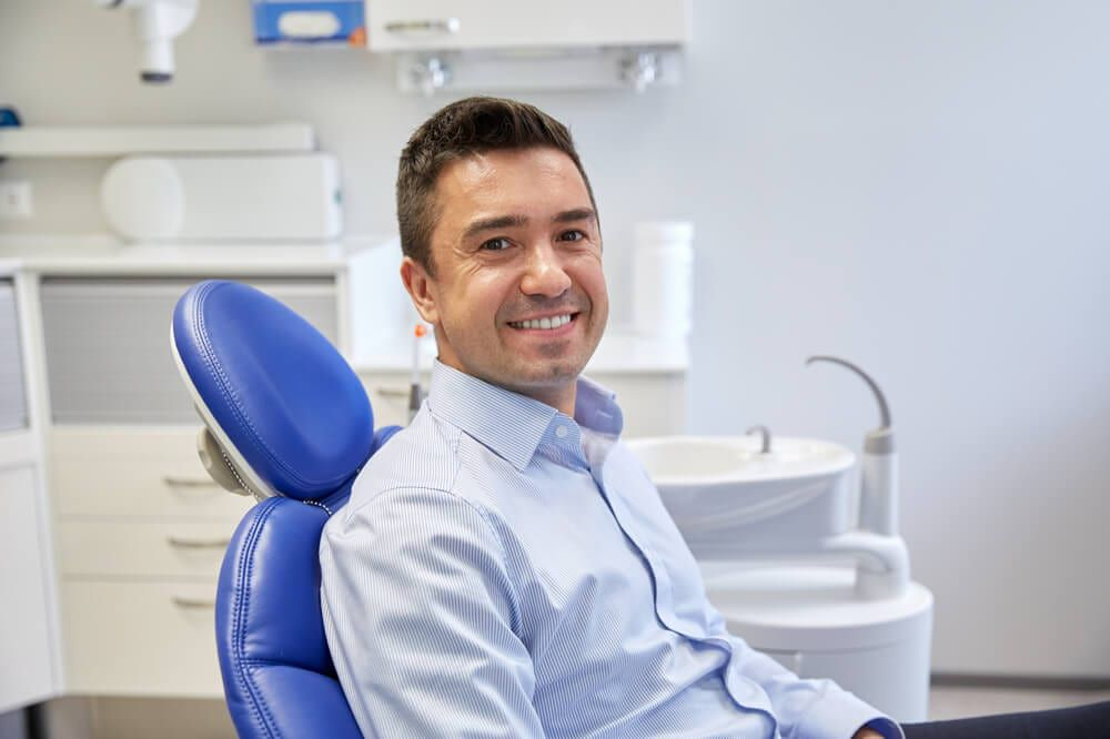 featured imaged for services post, dental patient in chair waiting on cleaning