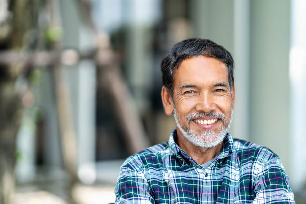 featured imaged for services post, smiling hispanic male with dentures