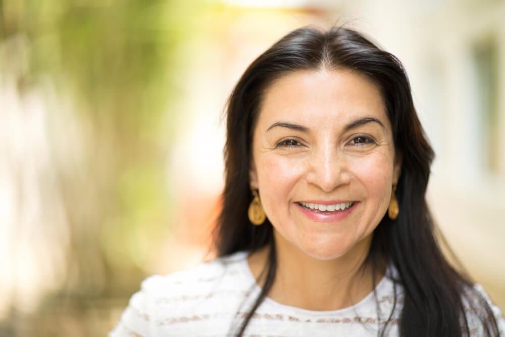 featured imaged for services post, smiling hispanic older female
