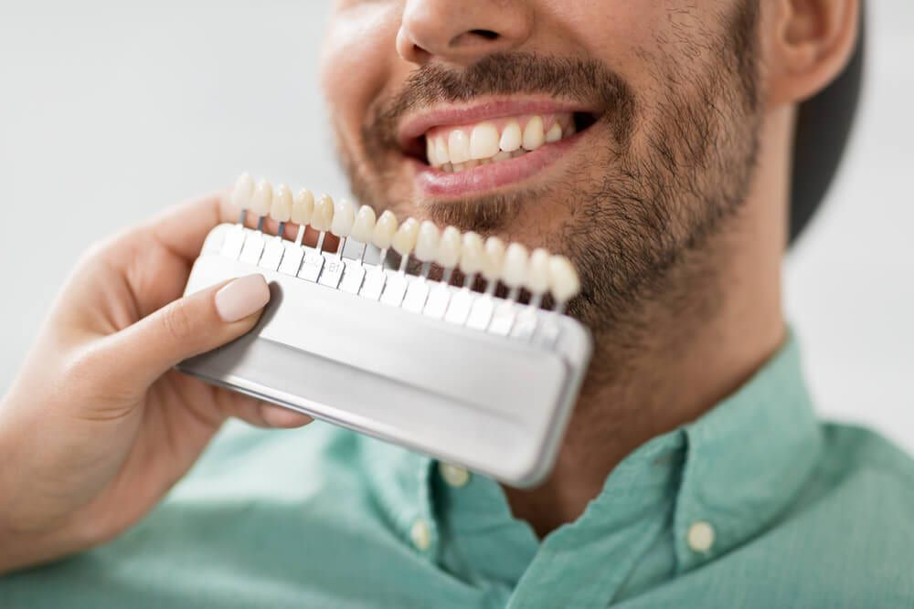 featured imaged for services post, smiling dental patient choosing whitening product
