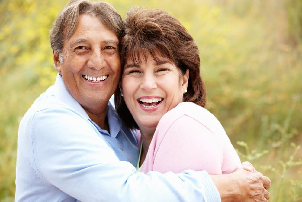 featured imaged for services post, smiling couple in fields