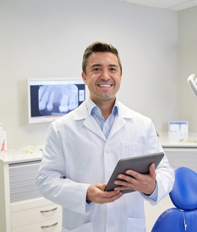 dentist standing in front of an xray