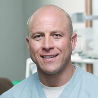 Dr. Shufflebarger in medical scrubs